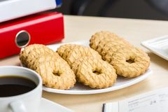 A break at work - time for something sweet. Let`s meet in the office with coffee and cookies Stock Photos