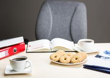 A break at work - time for something sweet. Let`s meet in the office with coffee and cookies Royalty Free Stock Images