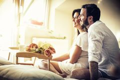 Let`s never leave the bed. Happy couple in bed. Space for copy stock images
