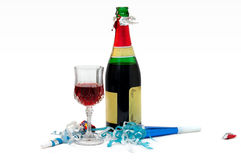 Let's the party begin!. Glass of red wine, bottle and party items Royalty Free Stock Photos
