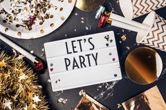 Let`s party on light box with party cup,party blower,tinsel,conf