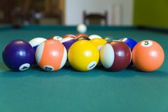 Let's play. Pool table with blurred white ball Stock Image