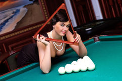 Let's play!. Luxurious woman waiting for players billiards Stock Image