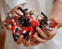 Hands of a Boy Holding Plastic Soldiers Royalty Free Stock Photography