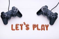 Let`s Play written by chocolate cookies Royalty Free Stock Photo