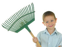 Let's Rake Some Leaves. Boy holding a rake Royalty Free Stock Photography