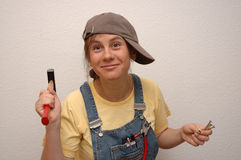 Let's repair something. Young girl with tools Stock Photography