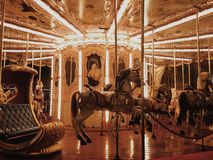 Let`s ride. A carousel by night. Come and let`s ride Royalty Free Stock Photos