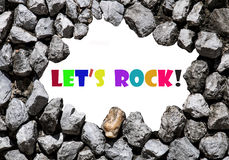Let's rock wrote on the stone wall Royalty Free Stock Photography