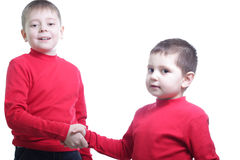 Let's shake hands. Two boys shaking hands isolated over white Royalty Free Stock Photos