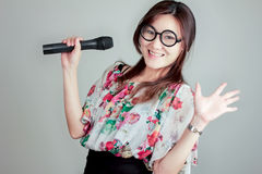 Let's sing. Cute asia girl ask you to sing a song Royalty Free Stock Image