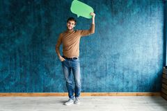 Let`s start a conversation. I speak the language of success. Handsome young man holding up speech bubble  on royalty free stock photos