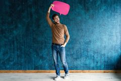 Let`s start a conversation. I speak the language of success. Handsome young man holding up speech bubble  on. Dark blue stock photos