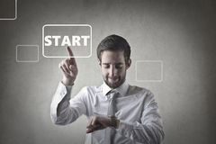 Let`s start. Man in shirt and with tie pointing at a `start` title Royalty Free Stock Images