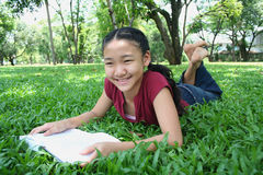 Let's study. Girl in the park Stock Photography
