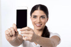 Let's take a selfie !. Beautiful woman taking a picture of herself Royalty Free Stock Photography
