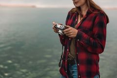 Let`s take some pictures. Beautiful woman enjoying her day taking pictures with her camera Stock Photos