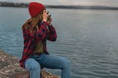 Let`s take some pictures. Beautiful woman enjoying her day taking pictures with her camera Royalty Free Stock Photography