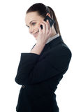 Let's talk business. Pretty businesswoman communicating isolated over white Royalty Free Stock Photos