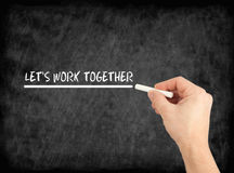 Let's work together - hand writing text on chalkboard Royalty Free Stock Photography