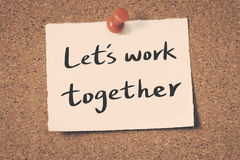 Let`s work together. Message on a bulletin board Stock Images