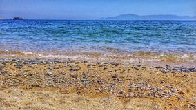 Let the sea wash your worries away!. Greece seaside love Royalty Free Stock Photography