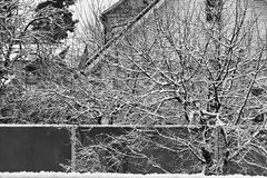 LET IT SNOW! Black and white shot of a snow-covered village. Villages in Ukraine are often idyllic in the winter months and after a snow fall stock photography