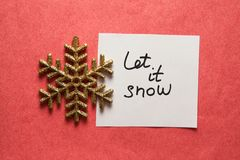 Let it snow - card with quote and golden glitter snowflake, weather in winter time. Let it snow - simple card with quote and golden glitter snowflake, cold royalty free stock images