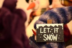 Let it Snow. Get ready from Christmas and the holiday season. Enjoy the winter season on the ski slopes stock images