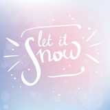 Let it snow. Hand written  lettering let it snow. White words on blurred pastel background Stock Image