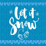 Let it snow. Inspirational winter quote, brush lettering at blue knitted texture. White text for Christmas greeting. Cards Royalty Free Stock Images