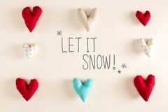 Let It Snow message with blue heart cushions stock photography