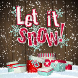 Let it snow, red text on brown wooden background with 3d effect and group of colorful giftboxes lying in snowdrift. Vector illustration, eps 10 with Stock Image