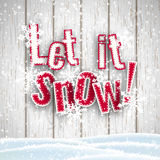 Let it snow, red text on white wooden background with 3d effect, illustration. Let it snow, red text on white wooden background with 3d effect and snowflakes Royalty Free Stock Photography