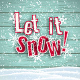 Let it snow, red text on wooden background with 3d effect, illustration. Let it snow, red text on blue wooden background with 3d effect and snowflakes, vector Stock Photography