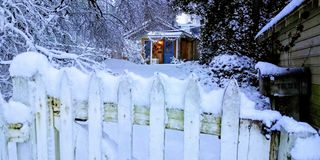 Let it Snow. Tiny cabin surrounded by snow stock photos