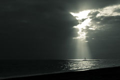 Let the sunrise. Coastal landscape during a sunset, some sunshine through the clouds escape Stock Photography