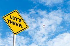 Let Travel road sign with blue sky and plane background Stock Image