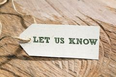Let us know. Word written on a Looking card stock images