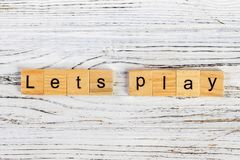 Let us play word made with building blocks. concept Royalty Free Stock Photography