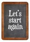 Let us start again on blackboard Royalty Free Stock Image