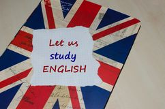 Let us study English message on paper note. English learning concept Royalty Free Stock Photography