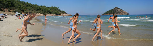 Let us swim!. A couple of young people running to the sea, Thassos, Greece Stock Photos
