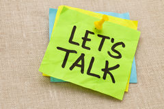 Let us talk on sticky note. Communication concept - let us talk - handwriting on a green sticky note against canvas board stock photos