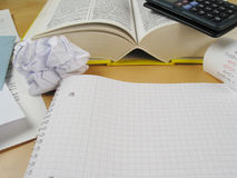Let us try it again!. Blank paper infront of calculator, book and bills wads Royalty Free Stock Photo