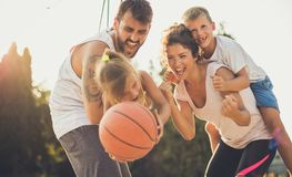 Let your children be happy with you. Family with basketball royalty free stock photos