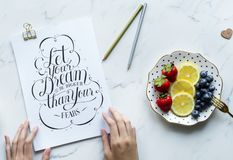 Let Your Dream Be Bigger Than Your Fears Signage Beside Plate With Fruits royalty free stock photo
