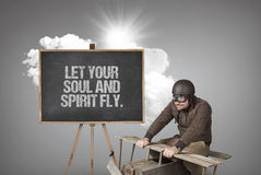Let your soul and spirit fly. text with businessman and wooden aeroplane Royalty Free Stock Photo