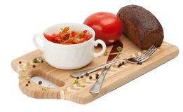 Letcho, tomatoes, black bread on a cutting board Stock Images