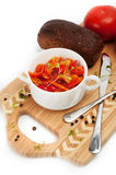 Letcho, tomatoes, black bread on a cutting board Royalty Free Stock Photo